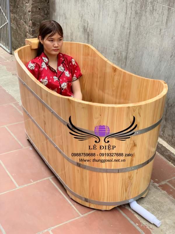 bồn tắm bằng gỗ pơ mu dáng nằm